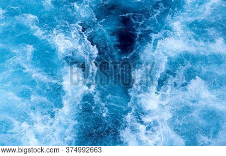 Ship Trail On Sea Water Top View Photo. White Foam On Blue Water. Ocean Transportation. Tropical Isl