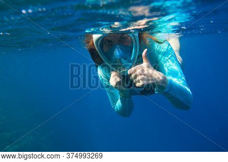 Young Woman In Snorkeling Mask Underwater Photo. Female Snorkel Show Thumb Undersea. Snorkeling In T