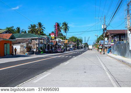 Dumaguete, The Philippines - 07 Apr 2020: Empty Highway Of Philippine Village During Coronavirus Qua