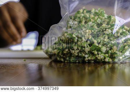 Woman Preparing Nigerian Okra Okra For Storage In A Freezer