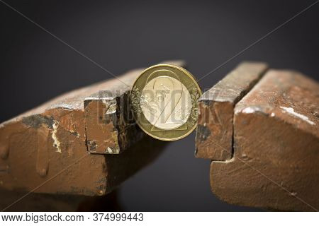 Coin In A Vise. Belarusian Rubles In A Metal Vise. Economic Problem