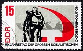 GDR - CIRCA 1967: a stamp printed in GDR shows Russian War Memorial Berlin-Treptow, 50th Anniversary of the Russian October Revolution, circa 1967 poster