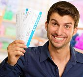A Young Man Holding Boarding Pass, Indoor poster