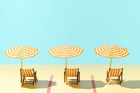 Beach With Sunbeds And Umbrellas Time After The Coronavirus Pandemic. New Normal Concept. Keep Safe