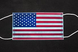 Protective Mask With The Usa Flag On A Black Slate Background. Independence Day During The Coronavir