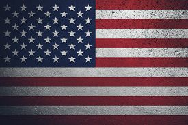Drawing Of The American Flag On A Textured Wall. Brutal Dramatic Background.