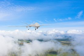 An Unmanned Vehicle Flies Over The Clouds Control And Tracking The Sky Over The Territory