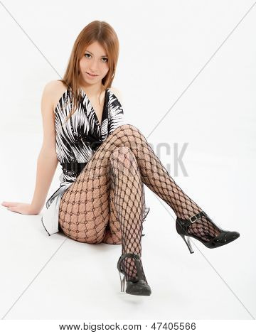 Young beautiful girl in a smart dress
