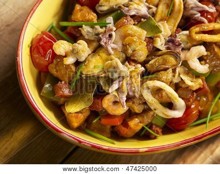 seafood dish with shrimps squid mussel served in a bowl poster