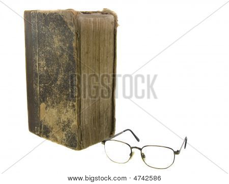 Glasses Near Very Old Bible On The White Background