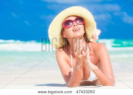Beautiful woman in white bikini on the beach. Travel concept