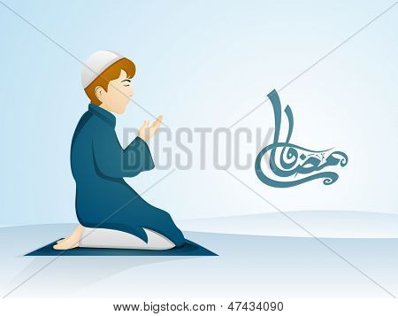 Arabic Islamic calligraphy of text Ramadan Kareem with illustration of a Muslim boy in traditional outfits praying (reading Namaz, Islamic Prayer) on abstract blue background.