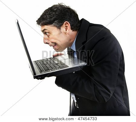 Humorous portrait of a furtive guilty man peering at x-rated content on his laptop computer with avid eyes, isolated on white poster