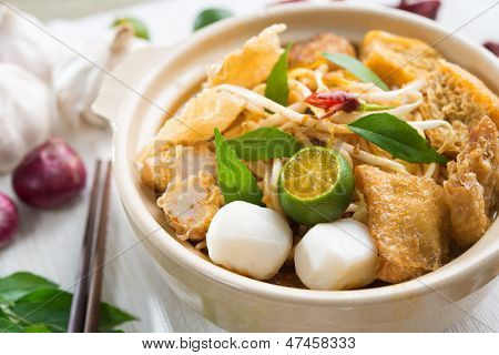 Hot and spicy Singapore Curry Noodle. A popular traditional spicy noodle soup in Malaysia and Singapore