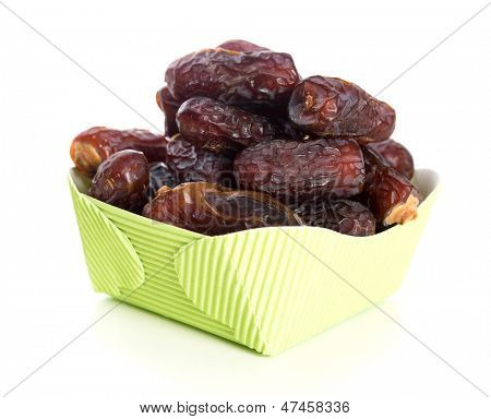 Kurma dried date palm fruits, ramadan food which eaten in fasting month. Pile of fresh dried date fruits in paper box.