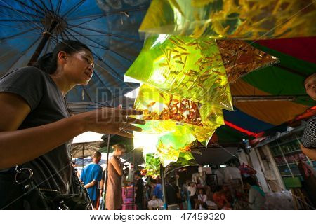 BANGKOK, THAILAND - APRIL 24: Unidentified seller in fishmarket at Chatuchak Market Apr 24, 2012 in Bangkok, Thailand. Is one of the world's largest markets covering over 35 acres with 15,000 stalls.