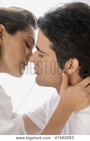 Studio shot of couple about to kiss
