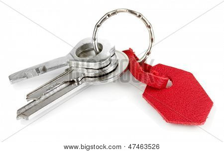 Key with leather trinket isolated on white