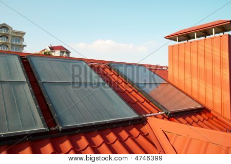 Alternative Energy- Solar System On The House Roof.