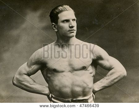 KALISZ, POLAND, CIRCA THIRTIES - vintage photo of muscular man with naked torso, Kalisz, Poland, circa thirties