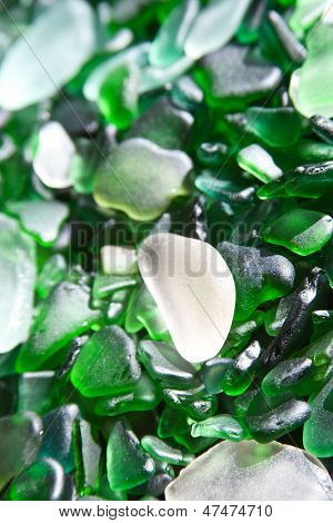 glass pieces polished by the sea background