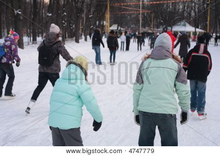 People On Skating Rink In Park