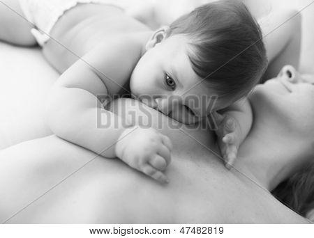 Mother breastfeeding baby girl child