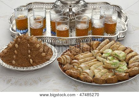 Traditional Moroccan tea,cookies and almond sellou at id-al-fitr the end of Ramadan