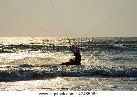 Kiteboarder Enjoy Surfing In The Sea