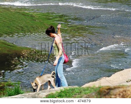 poster of girl walking dog in the park ** Note: Slight blurriness, best at smaller sizes