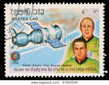 LAOS - CIRCA 1985: A stamp printed in Laos shows Soyuz 19 and crew A. Leonov and V. Kubasov with inscription and name of series