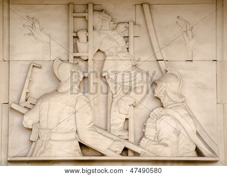 Firefighters on ladders sculpture