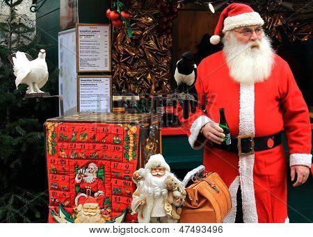 INNSBRUCK, AUSTRIA -- CIRCA NOVEMBER 2012: Unidentified Santa enjoys a beer at the Christkindlmarkt.