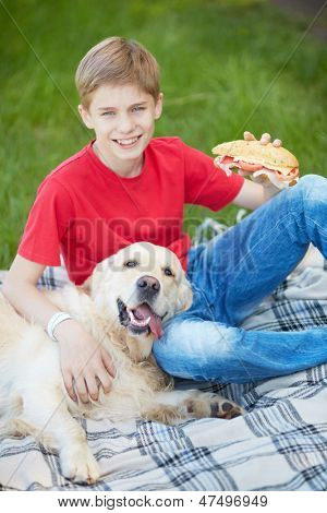 poster of Portrait of cute lad and his fluffy friend on a picnic