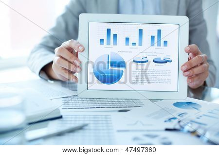 Close-up of businesswoman presenting financial situation in touchpad