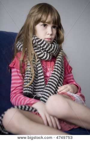 Llittle Cute Sick Girl With Scarf. Sore Throat