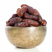Dates.  Kurma dried date palm fruits, Ramadan food which eaten in fasting month for Muslim. Pile of fresh dried date fruits in a bowl. poster