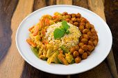 Vegetarian biryani rice or pilau rice with curry, fresh cooked basmati rice with spices, delicious Indian food. poster