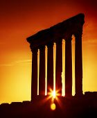 Old columns over sunset, Jupiter's temple of Baalbek, Lebanon, ancient city ruins,historical roman architecture, travel and tourism concept poster
