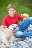 Portrait of cute lad and his fluffy friend on a picnic poster
