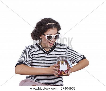 Young woman with a jar of candies
