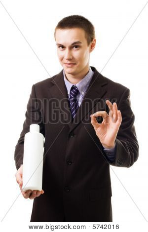 Young Businessman Advertise New Product Holding Blank Bottle