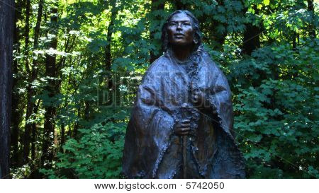 Native American Statue in Wooded Area