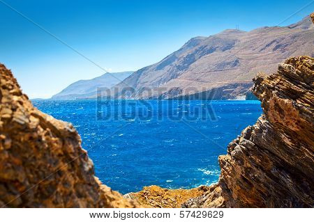 Lybian Sea Through Rocks