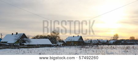 Winter rural landscape with sunset
