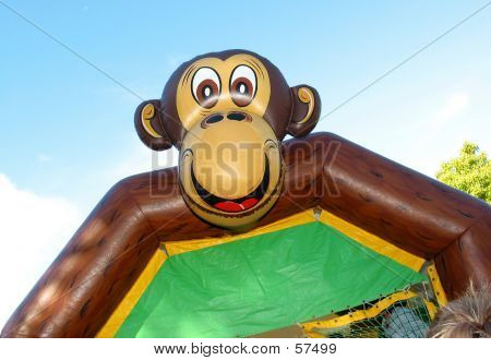 monkeying around... a kids outdoor bouncing castle... poster