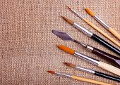 set of brushes on a canvas background poster