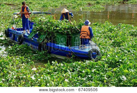 Vietnamese Sanitation Worker Working On Water