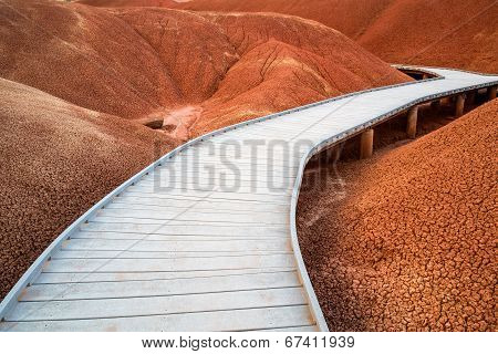Raised Walkway Through The Red Hills Of The Painted Hills