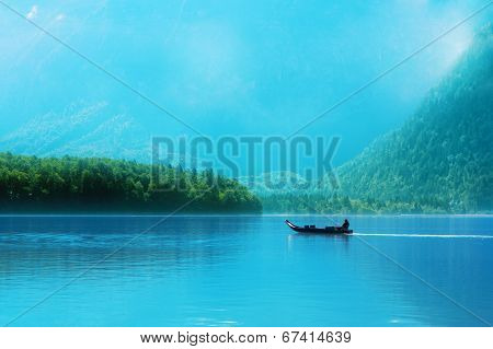 Small Boat On A Lake In The Alps